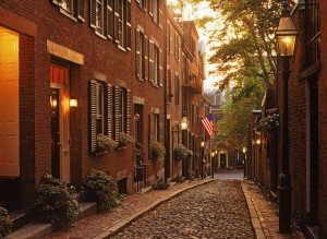 ARBHKA Alcorn Street with old lamps on Beacon Hill in Boston at dusk